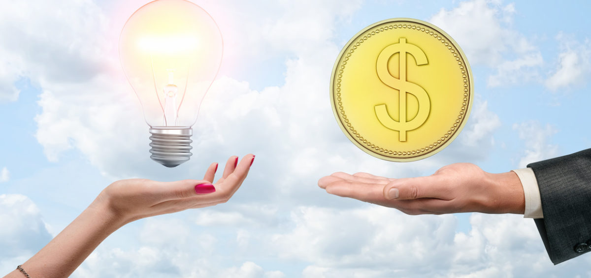 A woman hand with a light bulb and a man hand with a gold coin on a background of the sky with clouds. Selling ideas. Inspiration and wealth. Earning money for creativity.